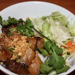 Grilled pork and springroll on rice vermicelli