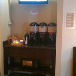 Self-serve coffee area near lobby