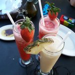 strawberry daiquiris and a piña colada