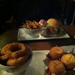 Cheech & Chong burger with fries, Pulled Pork Sliders with onion rings.