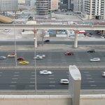 Zimmerausblick auf laute 12 -spurige Autobahn - Grand Midwest Dubai