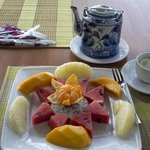 Fruit and green tea breakfast