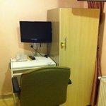 TV, desk and small wardrobe