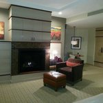 Rm 416 from bed, fireplace, sitting and dressing areas, TV above fireplace