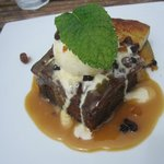 Rich Date pudding with vanilla ice cream, grilled banana drizzle with caramel sauce