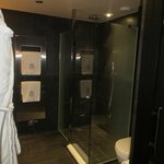 very spacious shower with hermes products