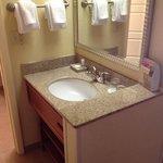 bathroom sink located outside the bathroom