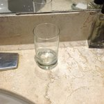 One water glass in a 4-person suite