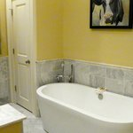 White marble surround and soaking tub in the Master Suite bathroom