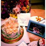 Our wedding anniversary cake, flowers for me, photo from our last trip and cupcake for my little