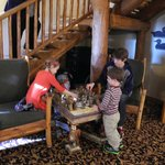 "children love ""playing chess"" in a nook under the stairs"