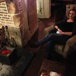 Sitting by the fireplace at The Windmill Inn