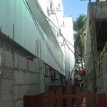 Left white hotel, one of 2 construction zones 24/7 noise, rooms only 1,5 m separted by open co