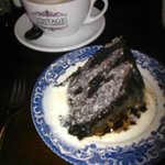 Chocolate cake, with pouring cream, washed down with Cappuccino at VCC