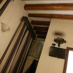Heavy drapes and ceiling beams in the room