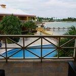 Balcony overlooking pool and beach.
