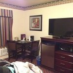 TV, mini fridge, microwave, and table