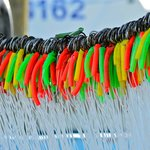 colorful lures from one of the boats by the boardwalk
