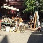 A cart piled with stuff at the Sunday flea market