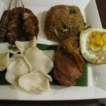 Nasi Goreng complete with fried egg, krupuk, 2 chicken satay, and a big of fried drumstick:) Lov