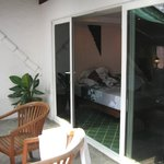 Entrance to the room - large bed with full bathroom. Close the door to turn on the air con.
