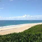 view of beach from bonito bay - coral reef on the right is swimming distance from shore - our hi