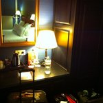 Night time view of side of the room w/cupboards and coffeemaker