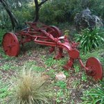 old farm machinery as decoration in the garden