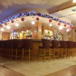 The bar of the Cross Square Hotel with Christmas decorations.