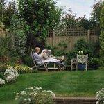 My mom relaxing in the lovely back garden