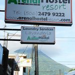 The hotel sign with Volcan Arenal behind