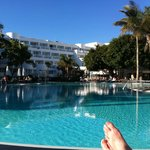 View of the hotel from across the pool (and my toe!)
