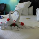 """Our room upon arrival. FREE """"Honeymooners"""" T-shirts and a FULL bottle of rum, too!!!"""