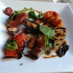 Seasonal grilled garden vegetables with prosciutto and sun dried tomato pesto
