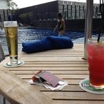 relaxing by the swimming pool with my drink, Spanish smile.