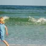 Our toddler running in and around the Destin surf.
