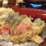 a mountain of mixed seafood, tofu, veggies...