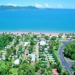 Beach front with a view of Dunk Island, with the Cassowary Conservation Area at the rear.