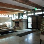 lobby with fireplace adjorns outdoor lobby with two fireplaces