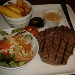 10oz Ribeye ultimate chips and blacka nd blue sauce.