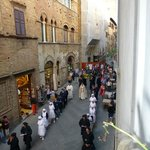 PROCESSION PASSING BY FROM ROOM WINDOW