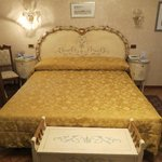 Beautiful Bed and Furnishings In Our Room