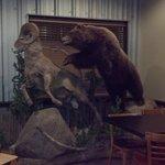 Bear chasing ram decor