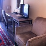 Standard room with desk, plazma TV, mini bar and comfortable sofa.