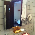 Standard room bathroom with all bathroom amenities.