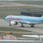 Thomson plane taxiing.Viewed from room