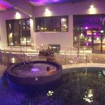 spa jacuzzi looking through windows to outdoor hot tubs