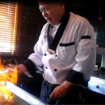 Jack fires up a flaming volcano of onion on the hibachi
