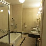 Delux Suite Bath Room with double sink, bath tab, shower booth