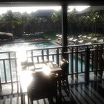 early morning sun, pool, breakfast area